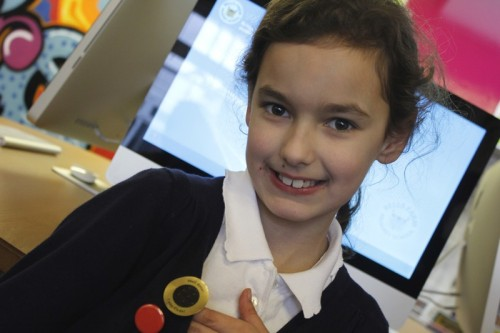 Isabel showing off her 'I can Code' sticker